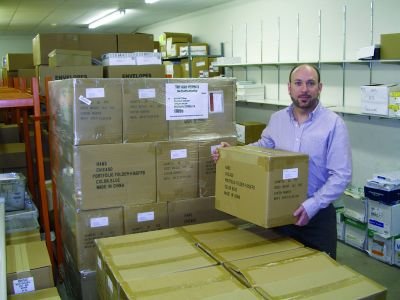 Director Dwayne Magee stands in Messiah College Press & Postal Services' warehouse, which the in-plant makes available to campus departments that lack storage space.