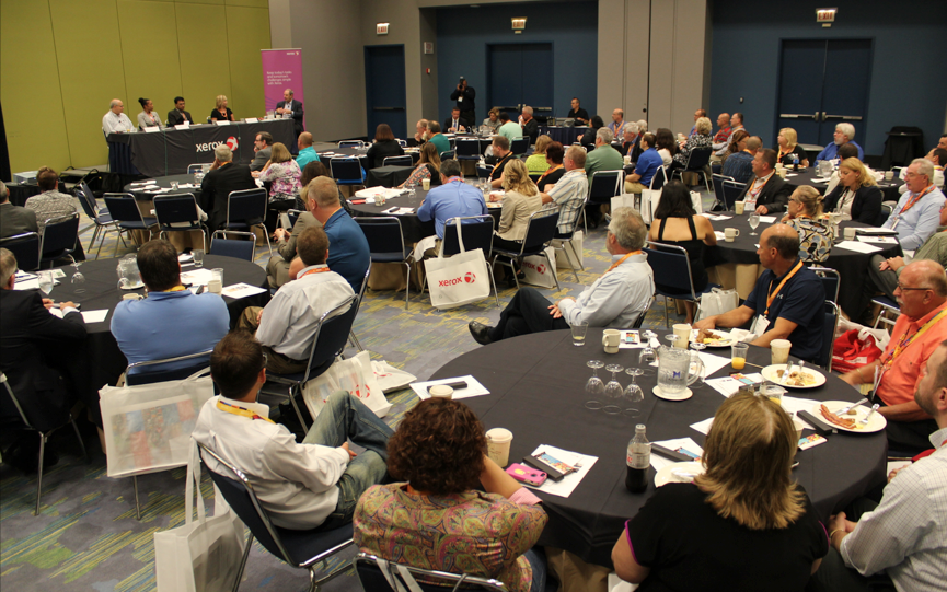 The panel of Xerox users shares ideas at the second in-plant breakfast.