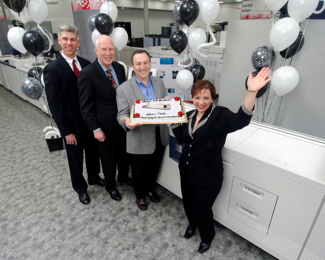 Blast from the past: 10 years ago, Xerox celebrated the DocuTech's 15th birthday with cake. From left: Xerox Executives Mike Kucharski, Frank Steenburgh, Tony Federico and Val Blauvelt.