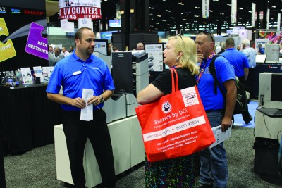 In-plant managers were everywhere at Graph Expo. Here, Catherine Chambers, director of Print & Mail Services at Alfred State, stops for a chat at the Formax booth.