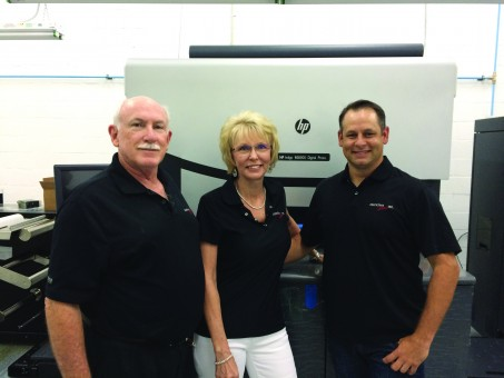 From left, Executive Label Owner Richard Preiser, Production Manager Peggy Preiser and Director of Operations Jason Raye with the company's HP Indigo WS6800.