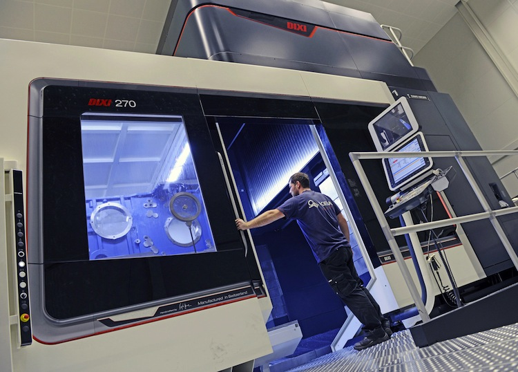 A high-tech DMC 270 (DIXI) milling machine processes large parts with painstaking precision in an air-conditioned room.