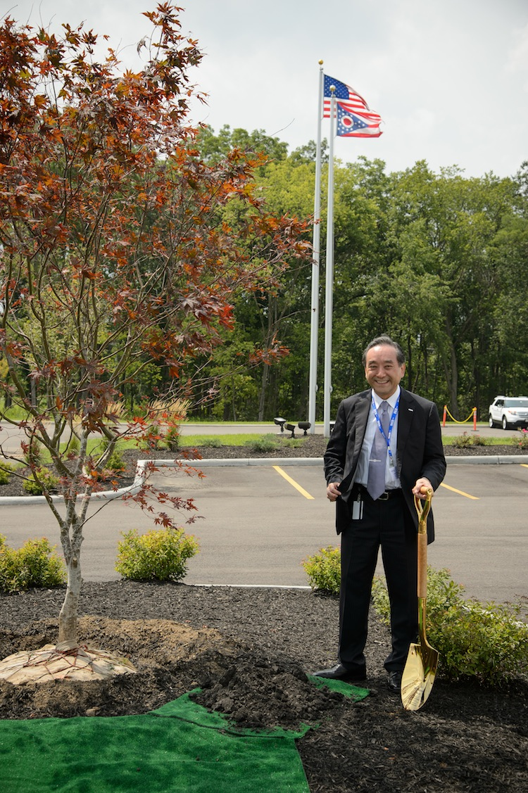Morita stands beside a Japanese maple tree at the Lebanon facility, a custom where the chairman plants a tree at each new facility.