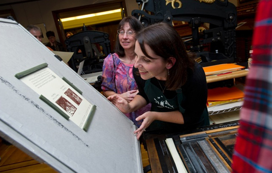 Amelia Hugill-Fontanel, assistant curator of the Cary, prints using the Kelmscott/Goudy press at its opening in October 2014. Image credit: A. Sue Weisler.