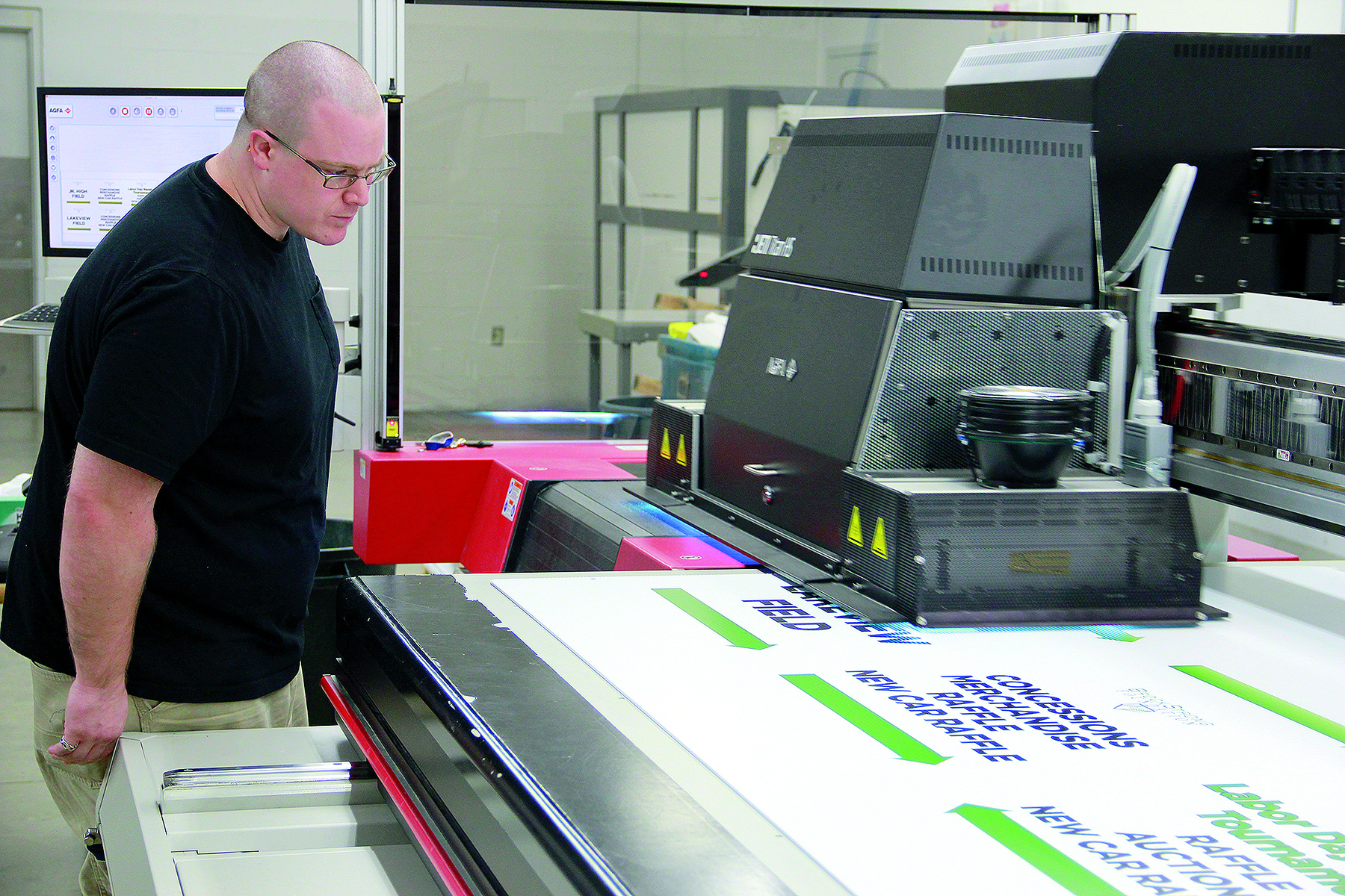 An Agfa Jeti Titan HS printer outputs point-of-purchase retail signage at Hopkins Printing.