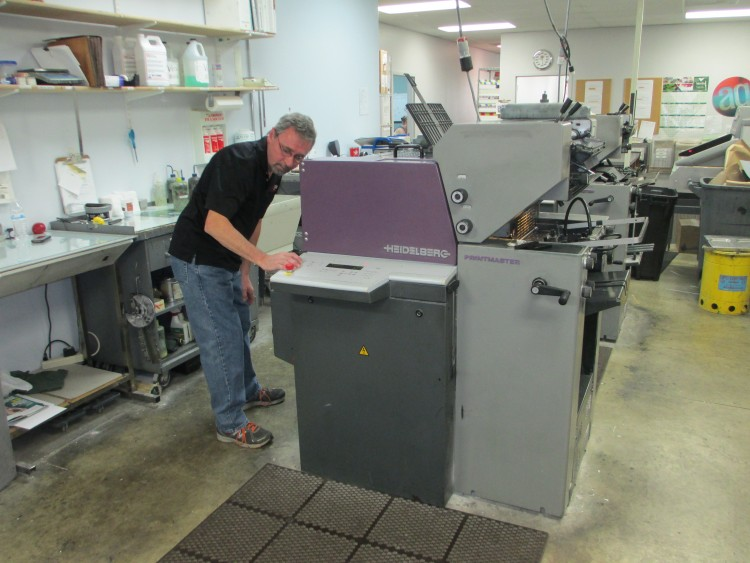 Senior Pressman Chip Hord operates a Heidelberg Printmaster press at the Arvada, Colorado, facility.